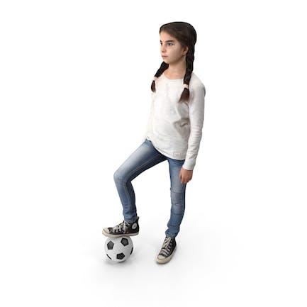Jugador de fútbol infantil posado
