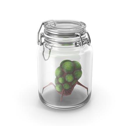 Glasgefäß mit außerirdischer Kreatur