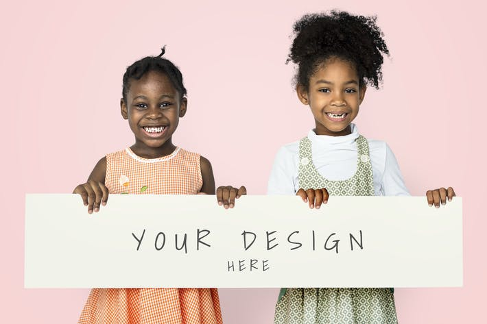 Cheerful little girls holding blank banner mockup