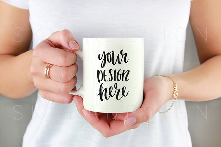Thumbnail for White coffee mug held by woman mockup