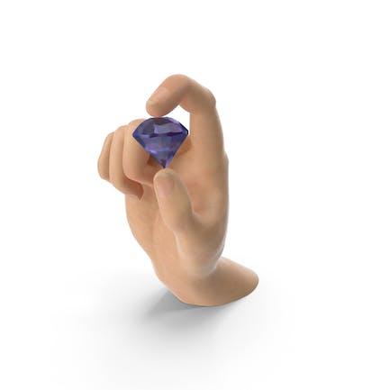 Mano sosteniendo un diamante amatista