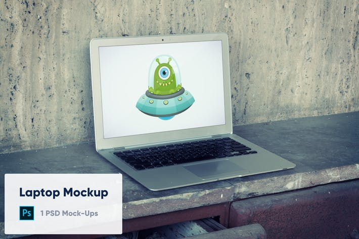 Thumbnail for Laptop on Old Concrete Background PSD Mockup
