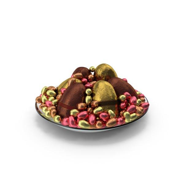 Teller mit gemischten verpackten Schokoladen-Oster
