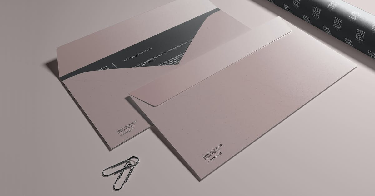 Download Two Envelope and Paper Tube Mockup by megostudio