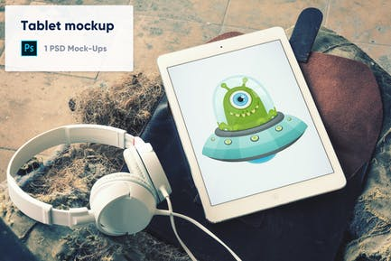 Tablet with Headphones on Leather Case PSD Mockup