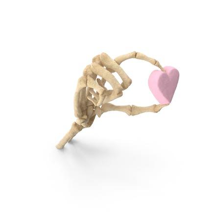Mano esqueleto sosteniendo un corazón de malvavisco