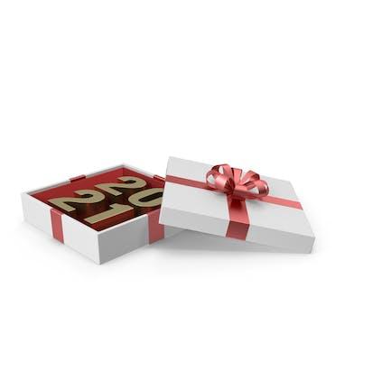 Gold Symbol 2021 in weißer Geschenkbox mit rotem Band