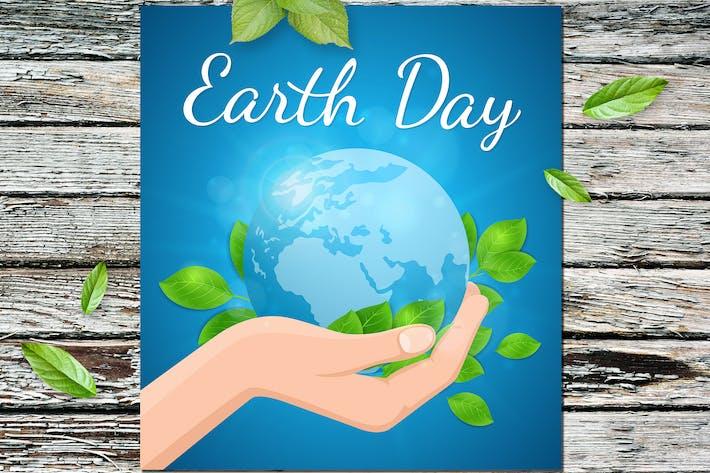 Planet Erde und grüne Blätter in der Hand
