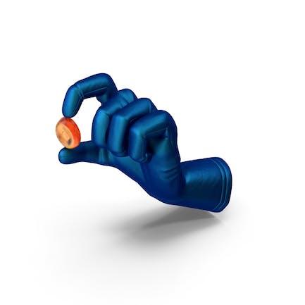 Glove Holding an Oval Hard Candy