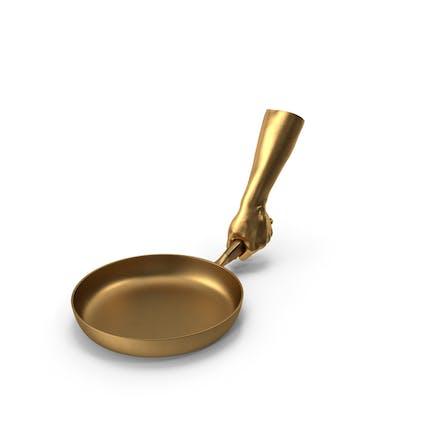 Golden Hand sosteniendo una sartén dorada
