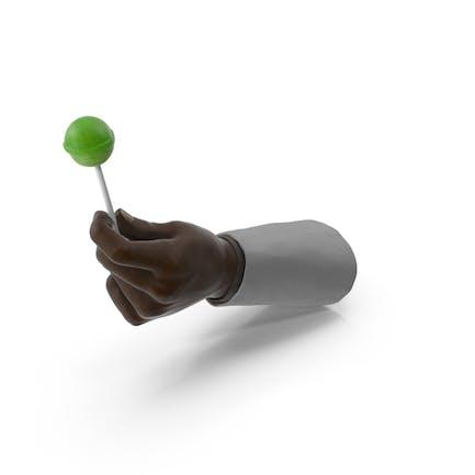 Traje de mano sosteniendo una piruleta