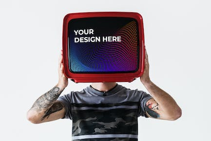 Person with tattoo holding television mockup