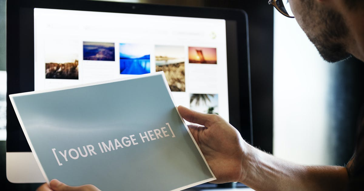 Download Photographer holding a mockup picture by Rawpixel