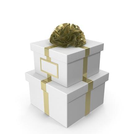 Weiße Geschenkbox mit Goldband und Karte