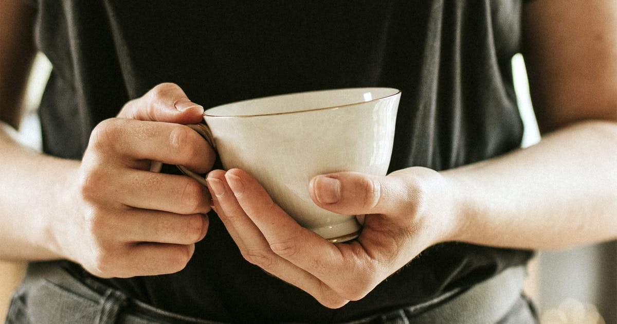 Download Woman with a tea cup mockup in her hands psd by Rawpixel