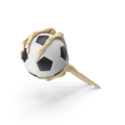 Skeletthand greift einen kleinen Fußball