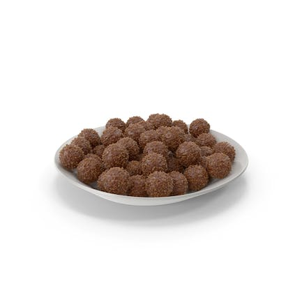 Plate with chocolate balls with nuts