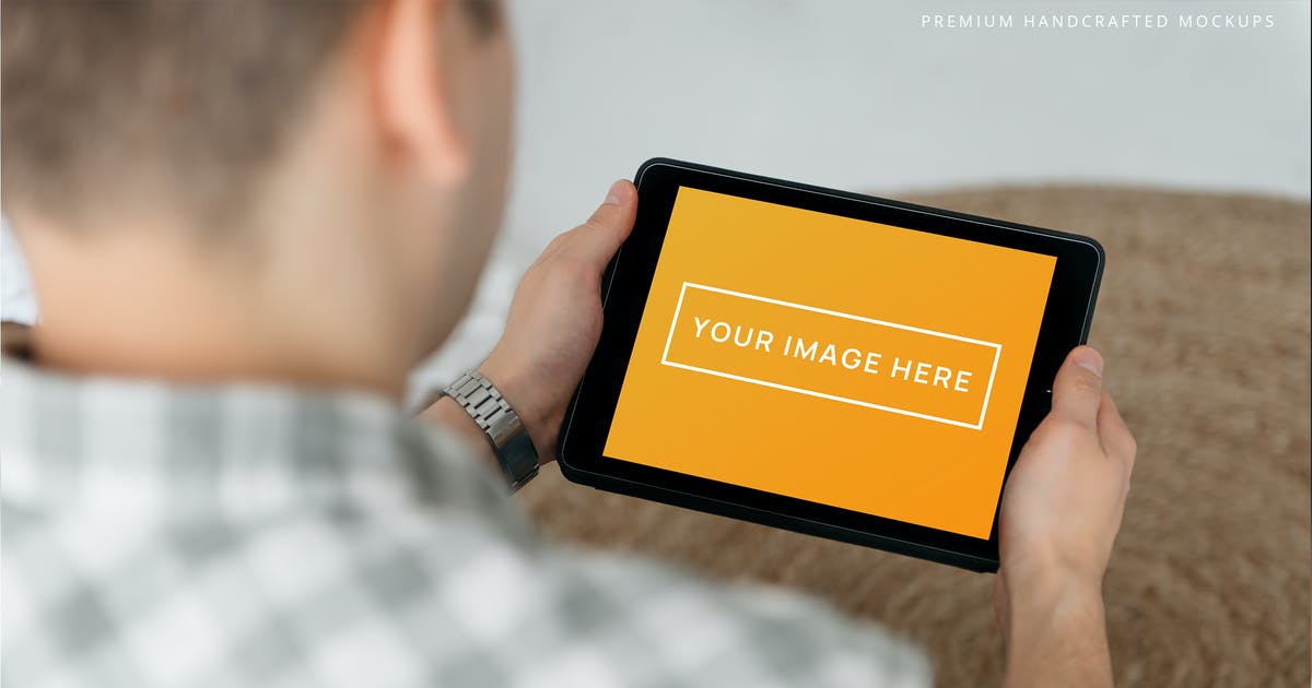 Download Person Holding iPad Photo Mockup at Home by zvolia