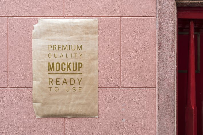 Poster mockup on a pink wall