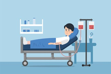 A sick person is in a medical bed on a drip.