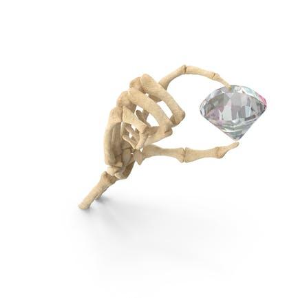 Mano esqueleto sosteniendo un diamante