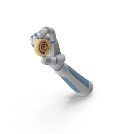Roboterhand hält einen kreisförmigen Schokoladen-Trüffel