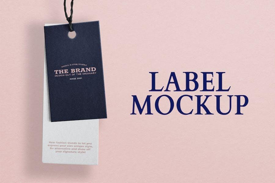 Etiketten-Tags-Modell mit rosafarbenem Pastell-Hintergrund