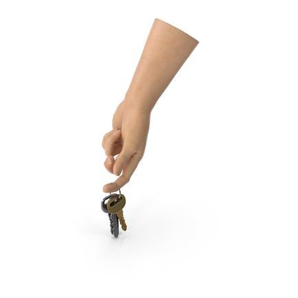 Hand hält eine Schlüsselkette