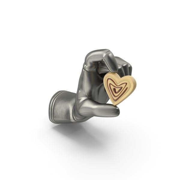 Перчатка, держащая шоколадный трюфель в форме сердца