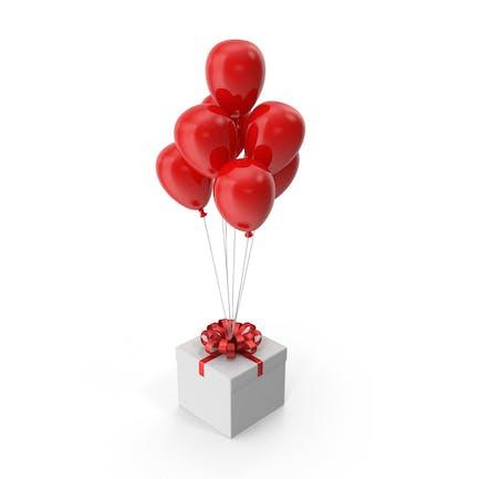 Geschenkbox mit rotem Band und roten Luftballons