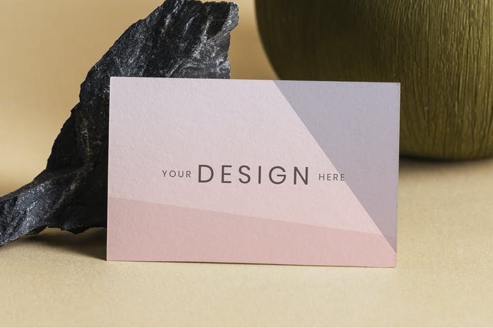 Blank business card on beige background mockup
