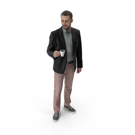 Mann stehend mit Kaffeetasse