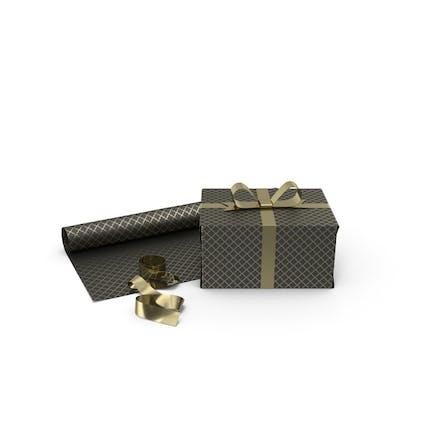 Geschenkbox mit schwarzen und goldenen Mustern mit Papierrolle und Goldfolienband