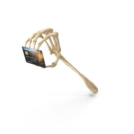 Mano esqueleto sosteniendo una tarjeta de crédito