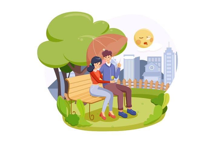 A happy couple sitting on a bench in autumn park