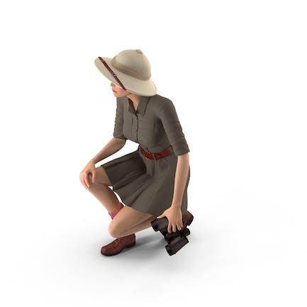 Frauen im Safari Kostüm hockende Pose