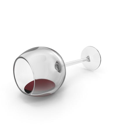 Copa de vino tinto derramada