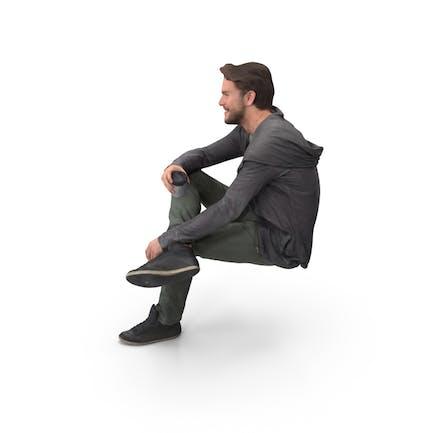 Mann sitzend