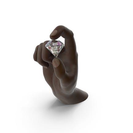 Mano sosteniendo un diamante