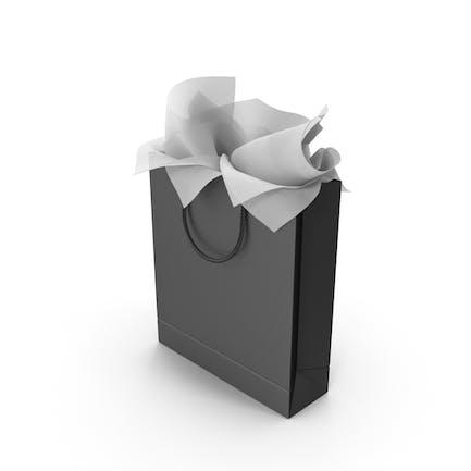 Bolsa de la compra negra con papel de regalo blanco
